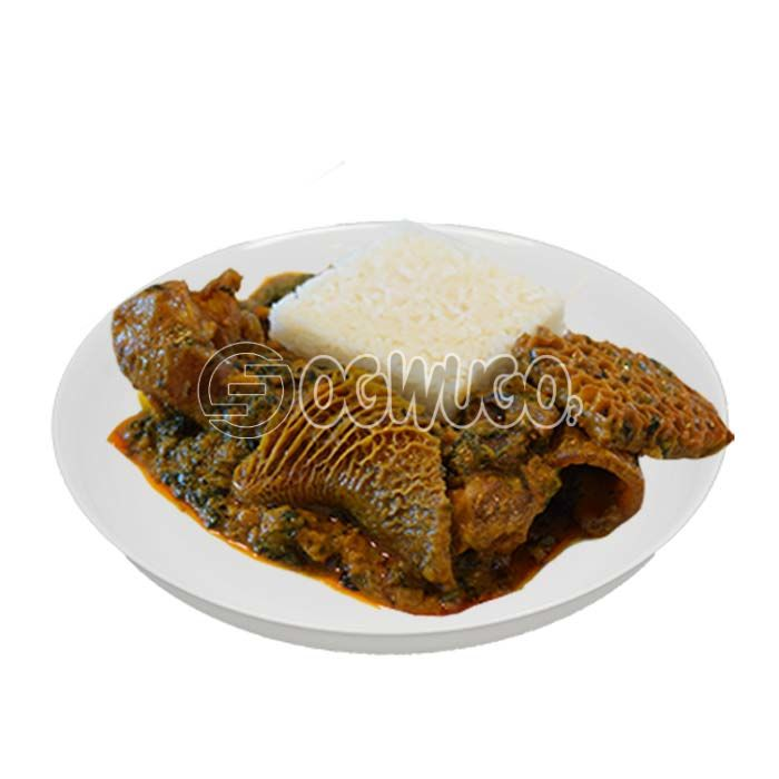 Hot delicious and tasty white Rice and Ofe-akwu with two pieces of beef.