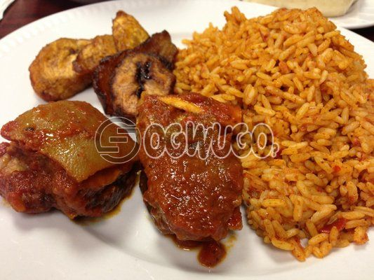 Jollof rice and two big beef. this meal is very tasty and will keep you energetic for the whole day.