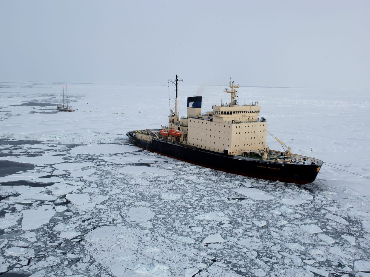 An image of a cargo ship crossing a large patch of ice by @noaa on unsplash.