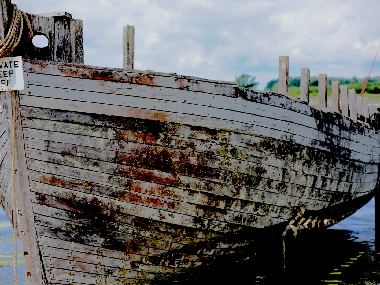 An image of an old white ship that is docked by @keithrpotts on unsplash.