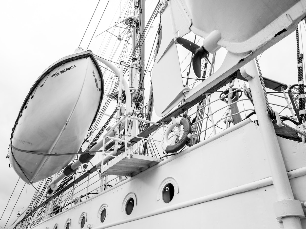 An image of a sailing ship in grayscale, by @turbaszek on unsplash.