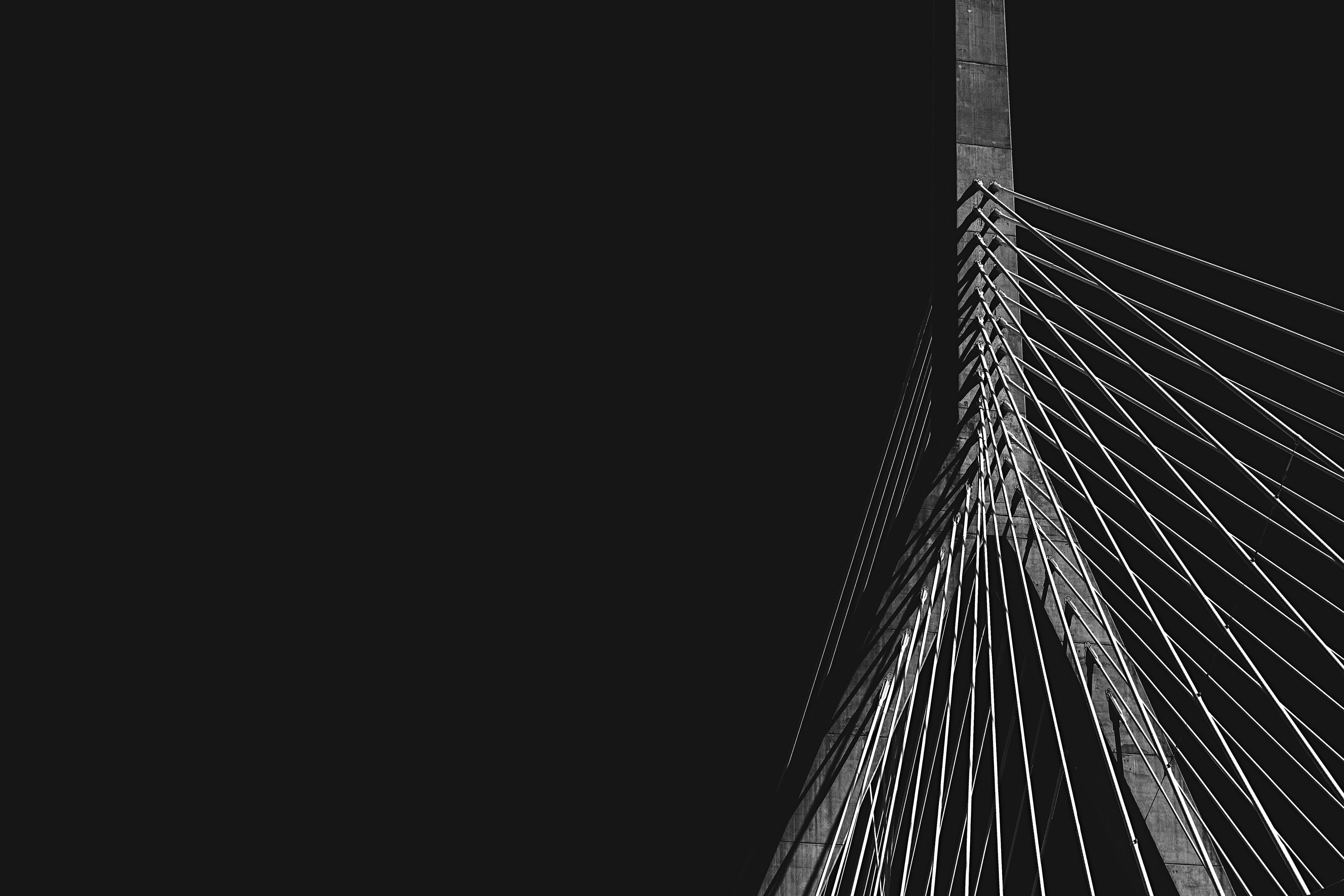 An image of a close up photo of a suspension bridge. By @osmanrana on unsplash.