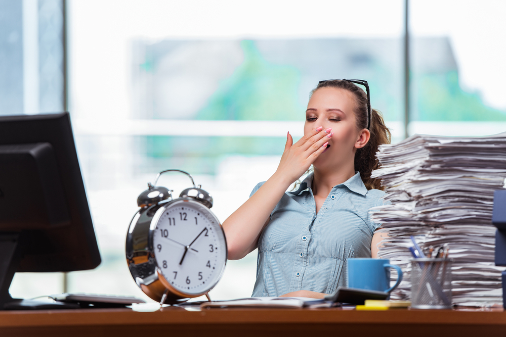 Long Work Hours? Here's What You Must Do To Avoid Back Pain