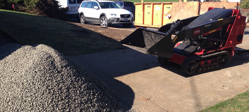 Ditch the wheelbarrow and rent a compact loader