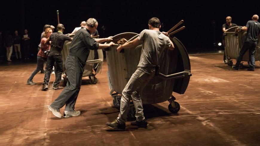 The stagehands preparing the floor
