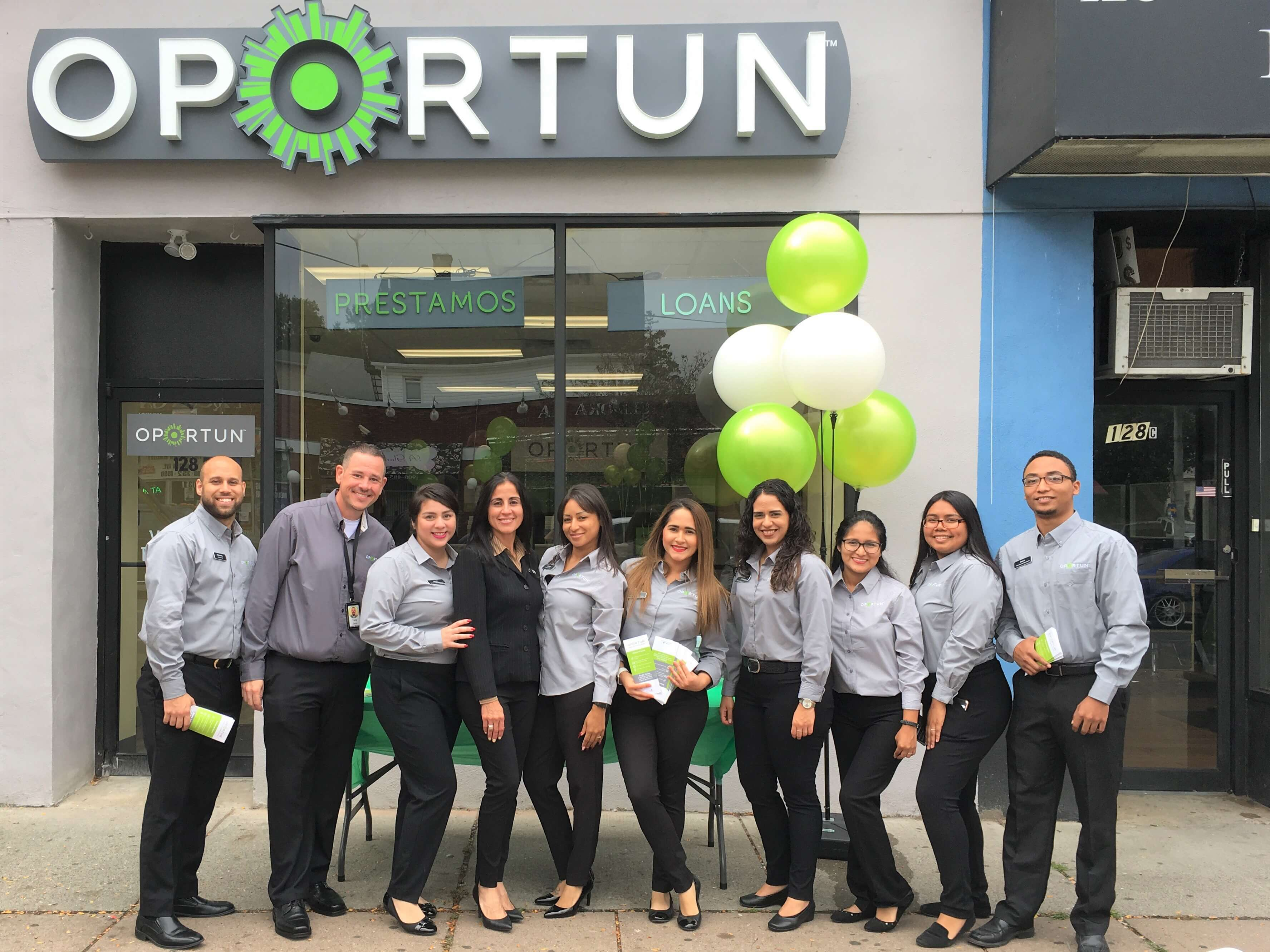 Oportun employees celebrate the opening of a new Oportun location.