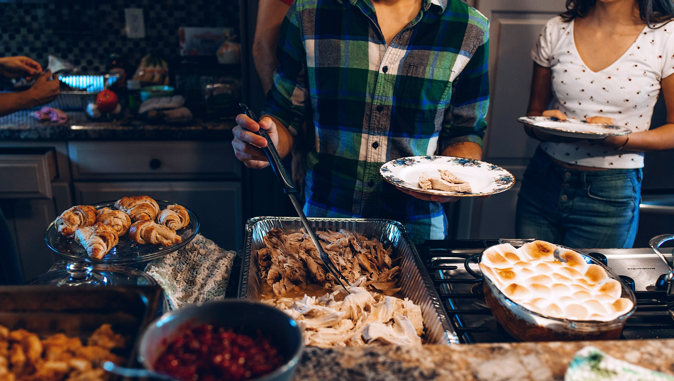 Family gathered around a Thanksgiving buffet they planned on a budget