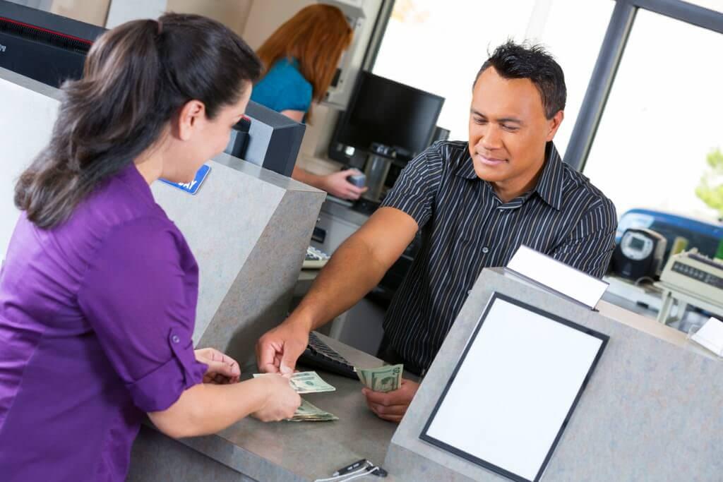 An Oportun customer receiving their loan installment.