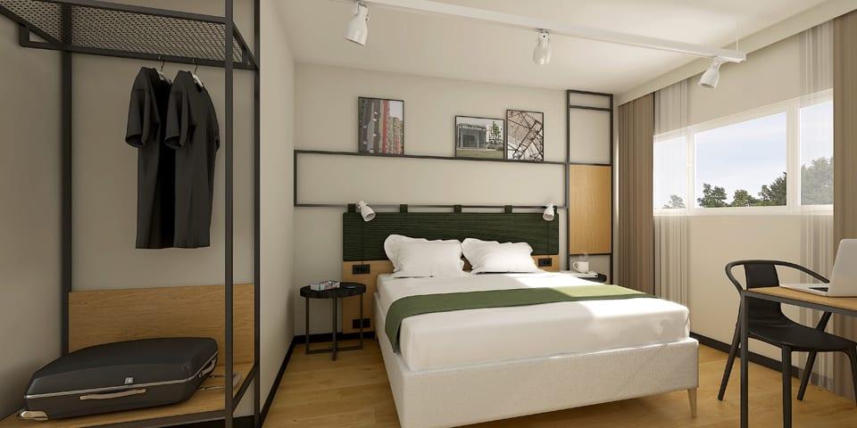 Décoration intérieure des chambres de l'Ibis Nanterre sous le concept Plaza