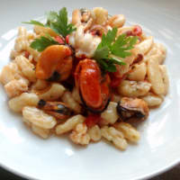 Homemade cavatelli with squid and mussels