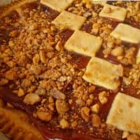Tarta con mermelada de arándanos y naranjas amargas y cacahuetes pra