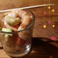 Shot of cashew shrimp with avocado and cherry tomatoes