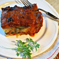 Zucchini flan, meat sauce with spices and smoked cheese