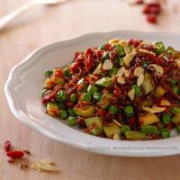 arroz rojo con guisantes, calabacín, goji y almendras