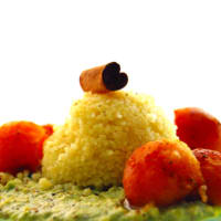 Cous cous with cream of peas nuts and pumpkin