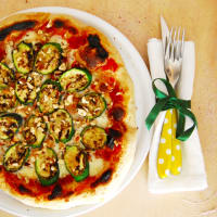 Pizza with zucchini, buffalo and hazelnuts