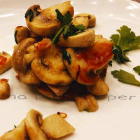 Button mushrooms sautéed with ham