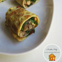 Wrap the frittata with arugula, mushrooms, sun dried tomatoes and walnuts