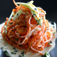 Noodles carrots with sesame sauce, orange and thyme