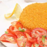 chuleta clásico con tomates marinados