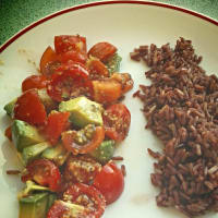 Red Brown rice with cherry tomatoes and avocado