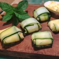Bundles of cucumber stuffed with pumpkin and mint