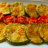 Zucchini and tomatoes baked potatoe