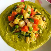 Mixed vegetables on pea puree
