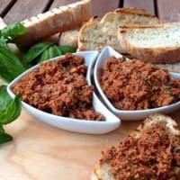 Delicious bruschetta with pesto dried tomatoes