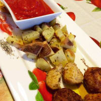 turkey meatballs with baked potatoes and pepper sauce