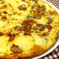 Omelette with mushrooms, potatoes and ham