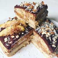 Cold figs stuffed cake, chocolate, almonds and coconut