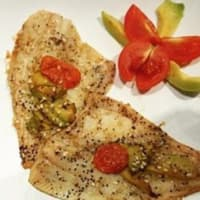 Fillets of plaice with avocado and tomatoes