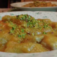 Whole wheat flour dumplings with pumpkin cream and chopped pistachios