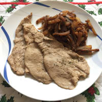 Slices of breast of veal with fennel and rosemary