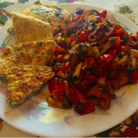 Egg omelet with basil garnish mediterranean
