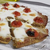 Meat Pizza with tomatoes and mozzarella