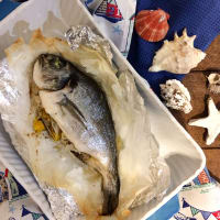 Sea bream baked in foil with citrus and pomegranate