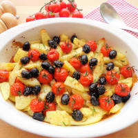 Baked potatoes with cherry tomatoes and olives