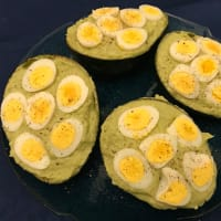 Avocado with tuna and eggs