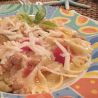 Farfalle with sausage and the scents
