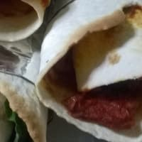 Wrap veg with nuts and raisins with tomato sauce