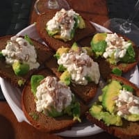 Rye bread with avocado flakes of milk and sunflower seeds