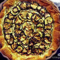 Salty cake of grilled zucchini, pine nuts and herbs