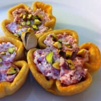 Brisée pasta baskets with ricotta, mortadella and pistachios