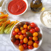 la pizza integral con ricotta, tomates y flores de calabacín paso 4