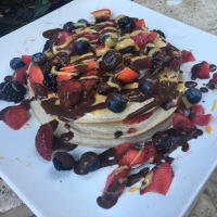 Pancake strawberries, creamy cocoa cream and peanut cream