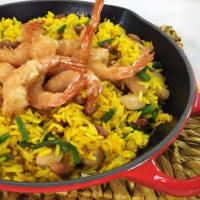 Yellow roasted rice with fantasy of beans and coconut shrimp