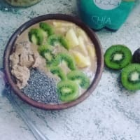 Smoothie bowl of cocoa, seeds and fruits