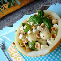 Salad of melon, feta and hazelnuts with basil